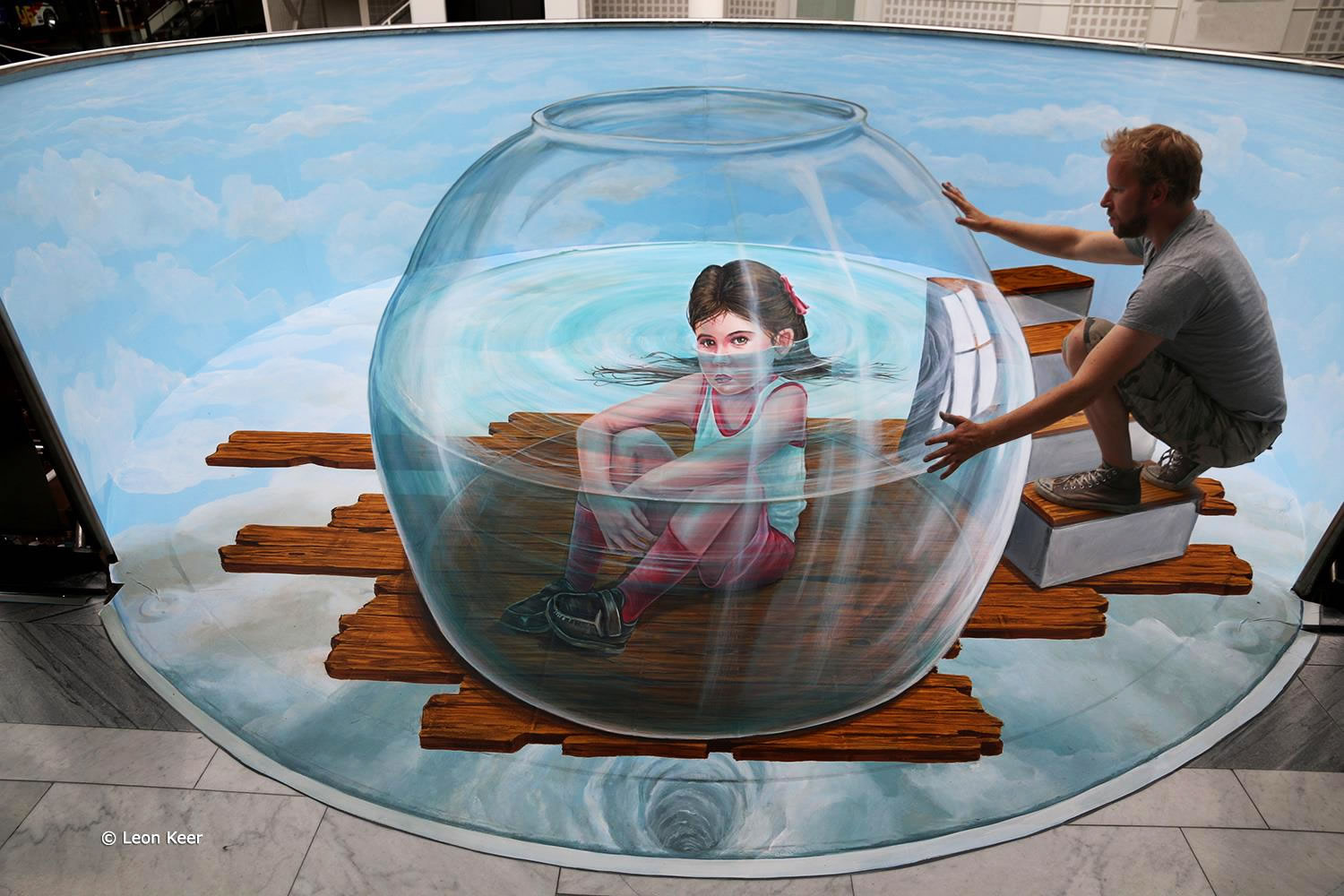 girl in bowl, anamorphic 3d art by leon keer