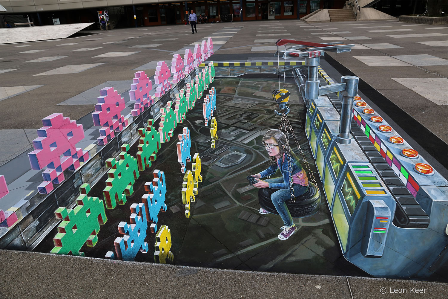 girl playing space invaders