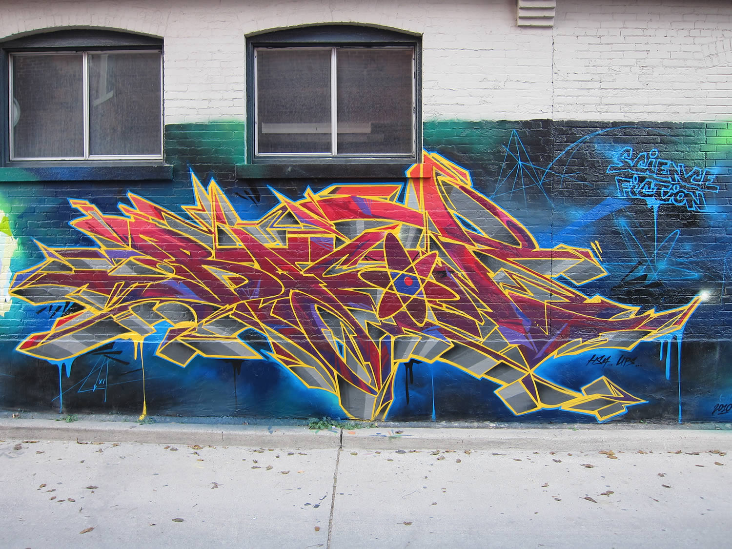 pink and yellow graffiti by bacon