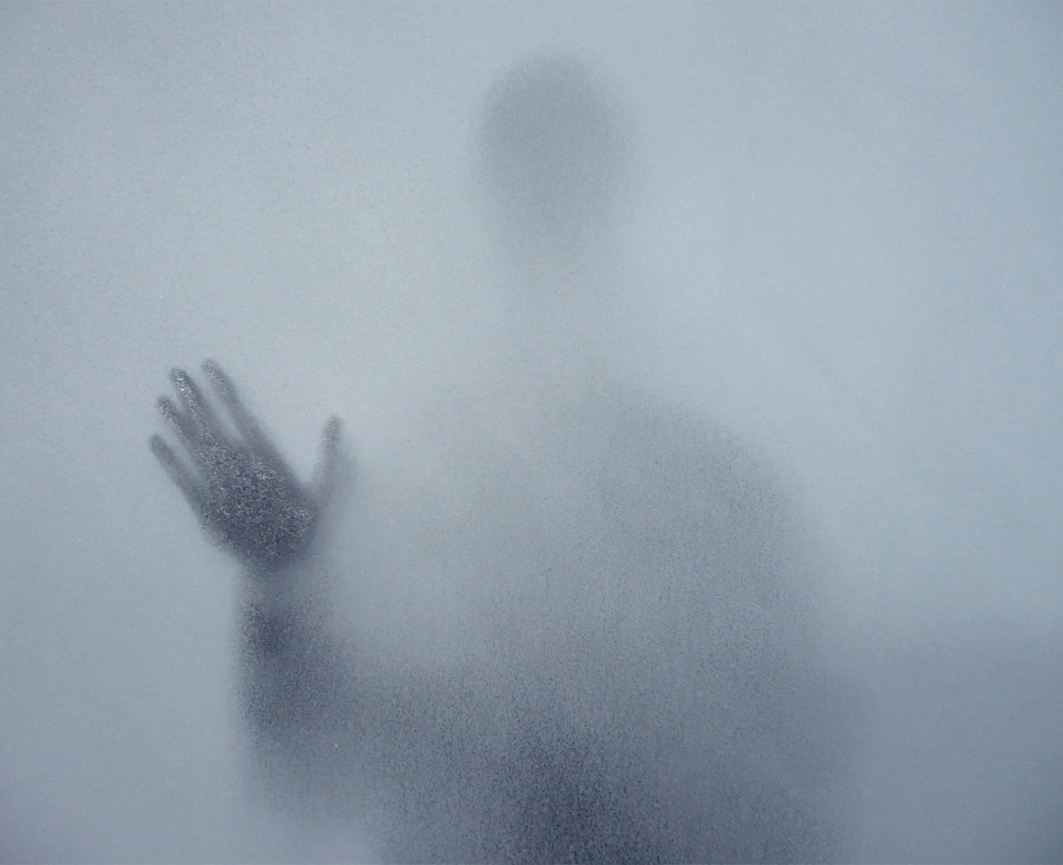 ghost like person with hand on a smokey window. drawing by hernan marin