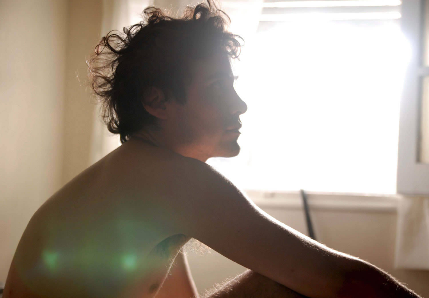 profile of man with sun from the window shining on him, Leo's Room