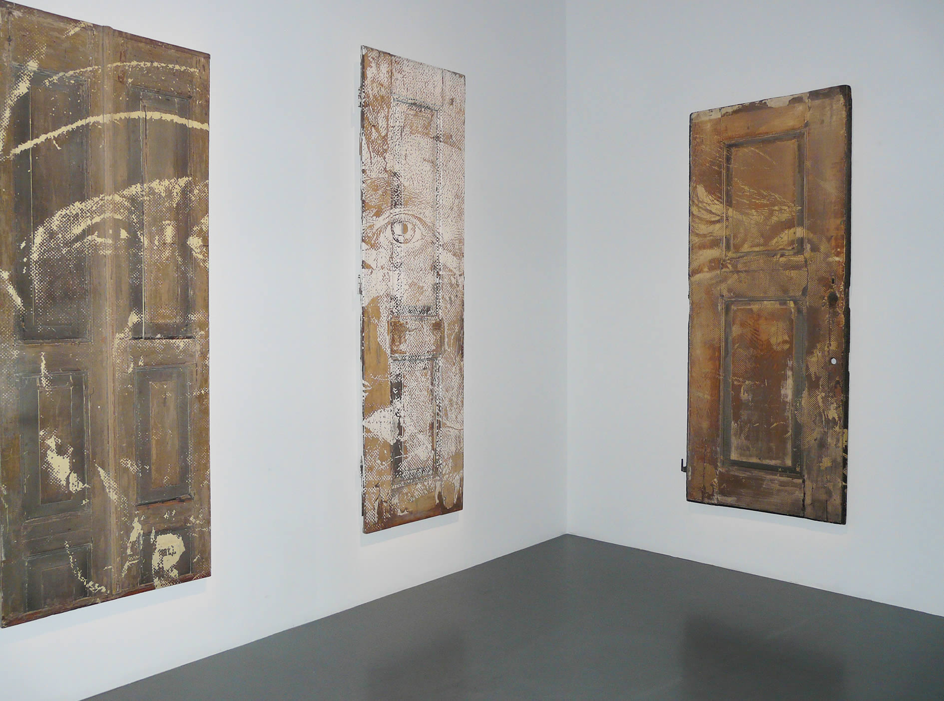 portraits on wood doors by vhils, from dissection series