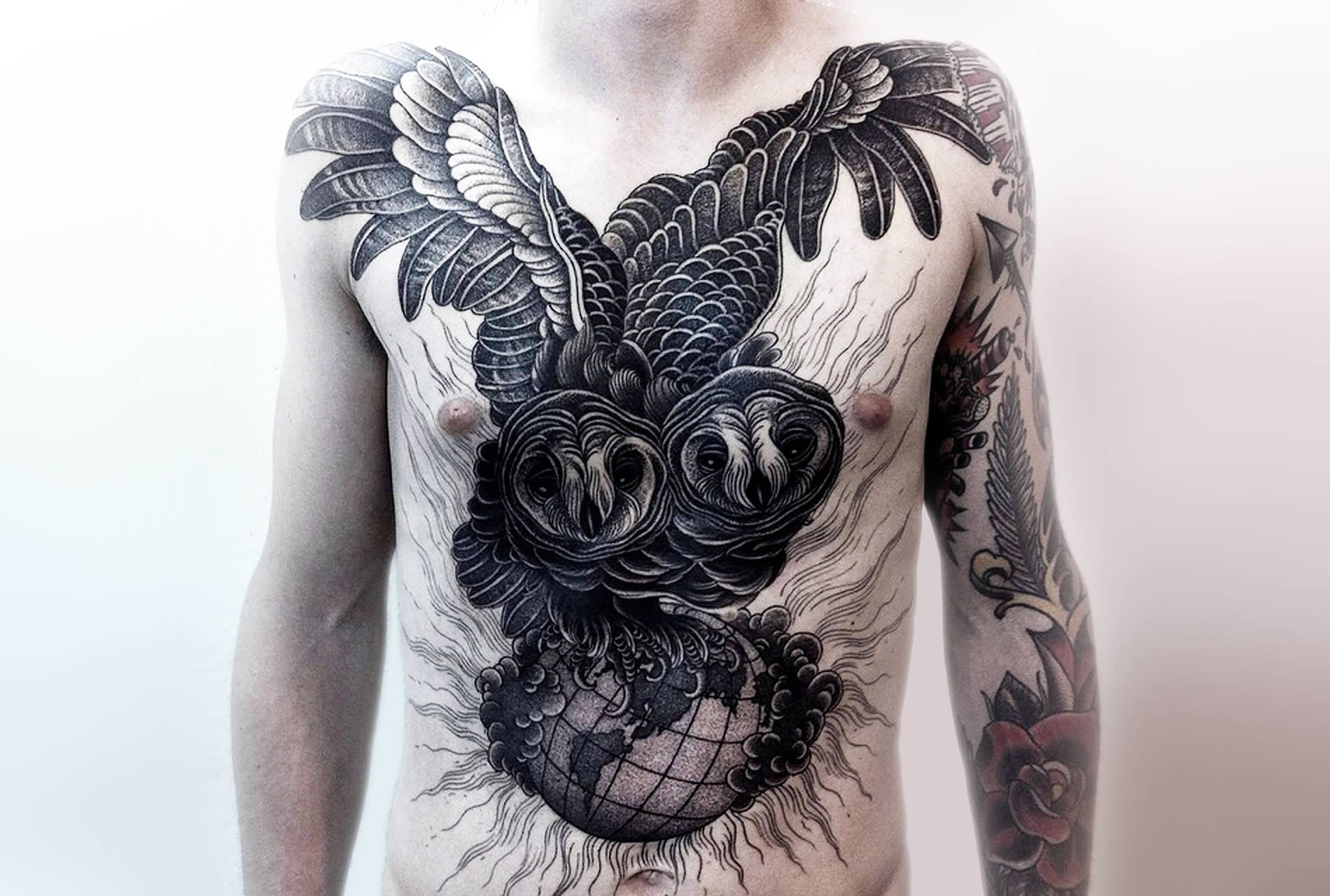 two owl heads tattoo on chest by alexander grim