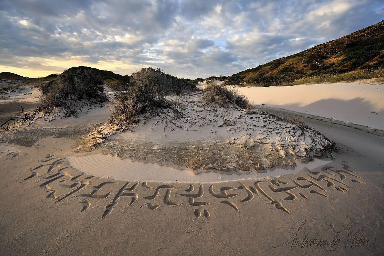 calligraphy around a dune