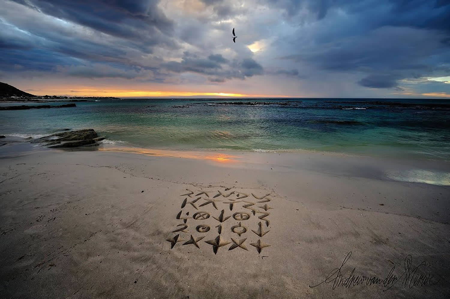 caligraphy and doodles on the beach in africa