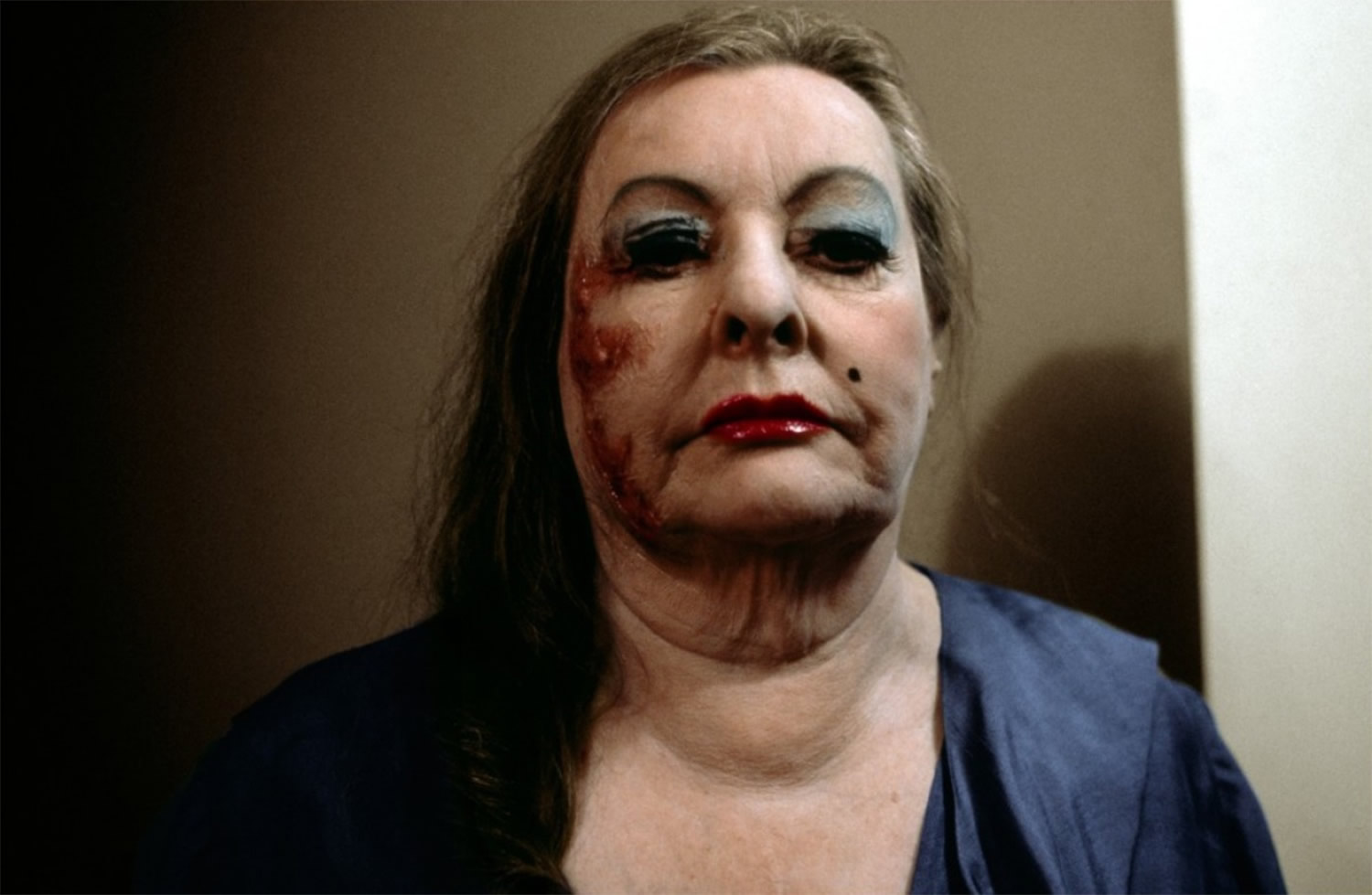 heavy makeup on woman's face in shivers, horror movie by cronenberg