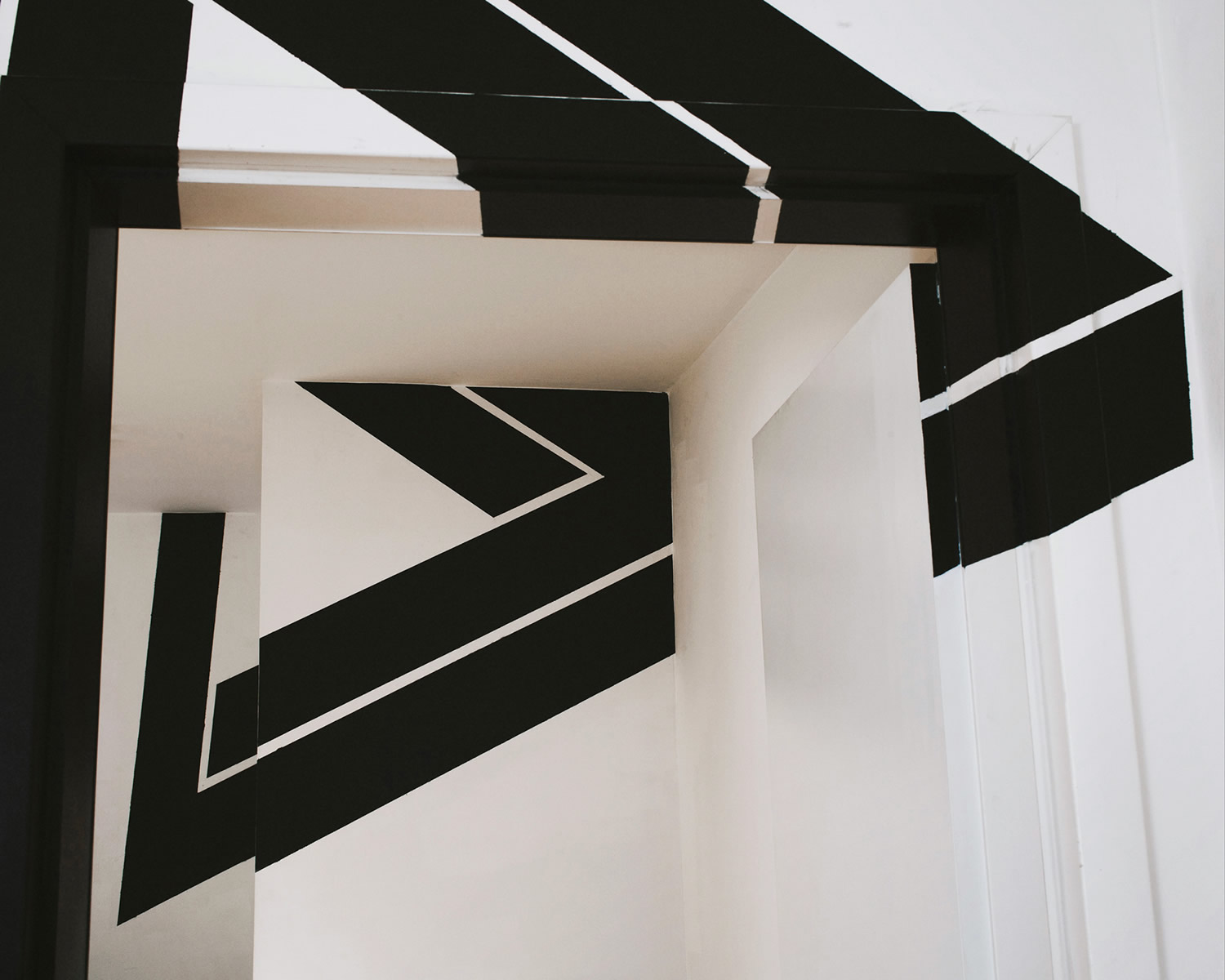 black paint penrose triangle, impossible object, Anamorphic art by fanette g.
