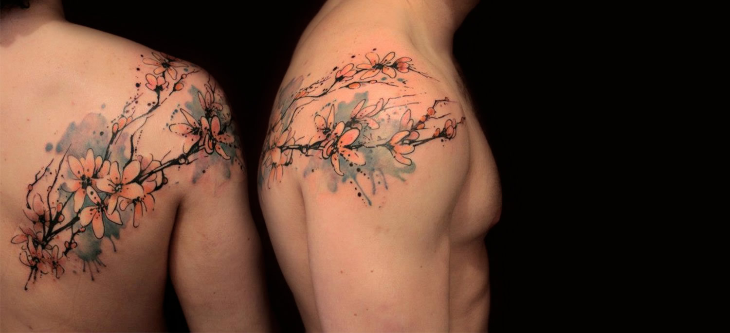 pink blossoms, watercolor tattoo by gene coffeey tattoo culture