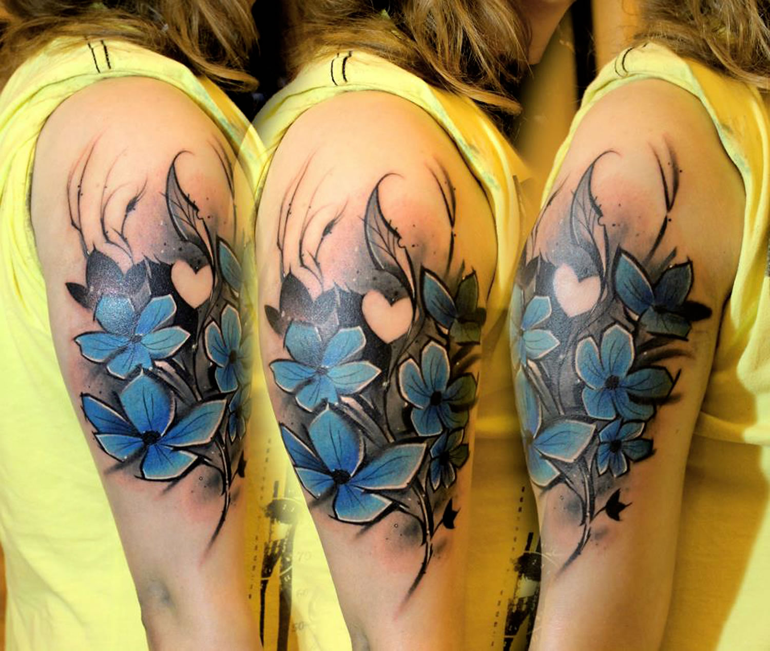 painterly blue flower tattoo by Lukasz Bam Kaczmarek