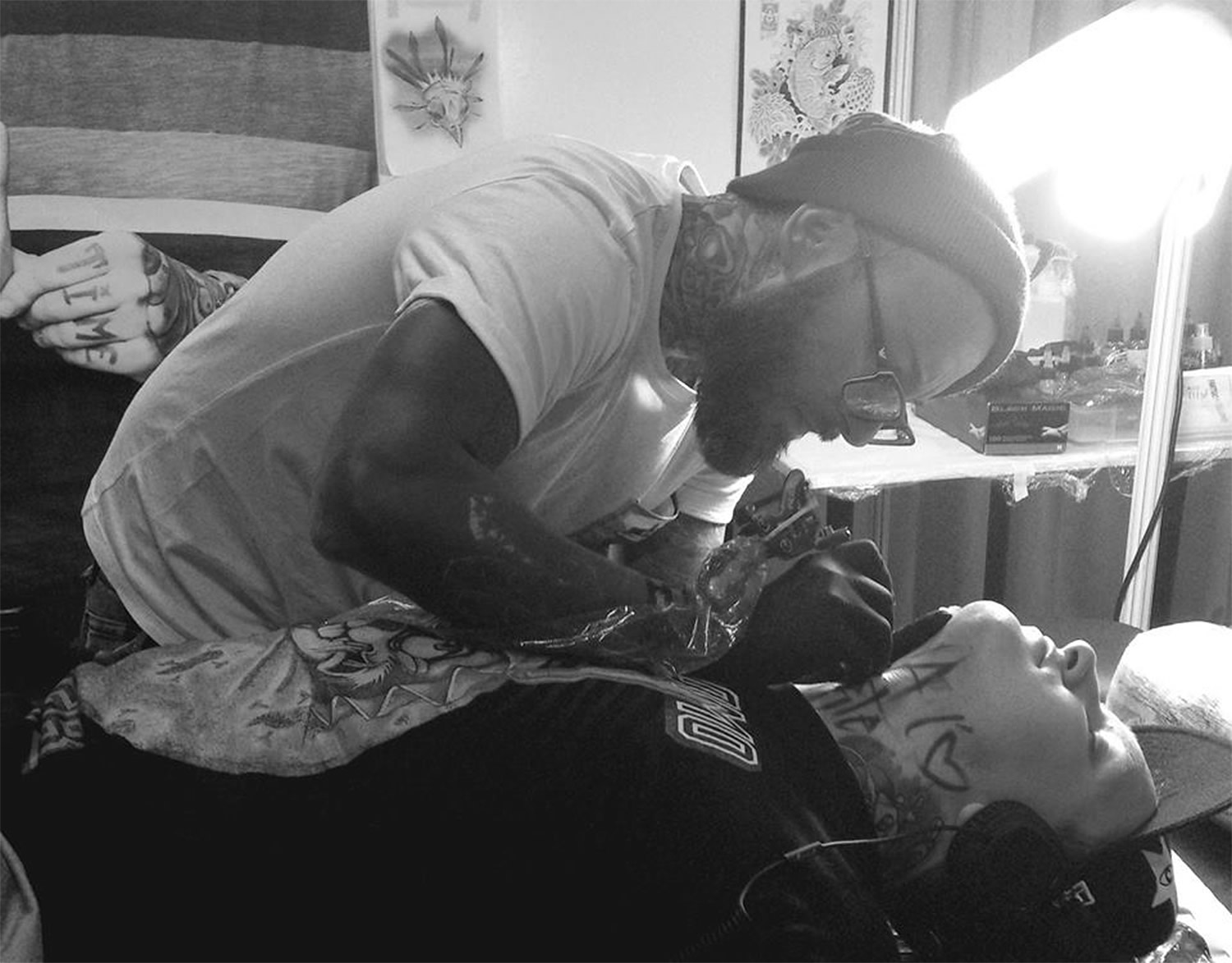 the artist Lukasz Bam Kaczmarek working on a tattoo