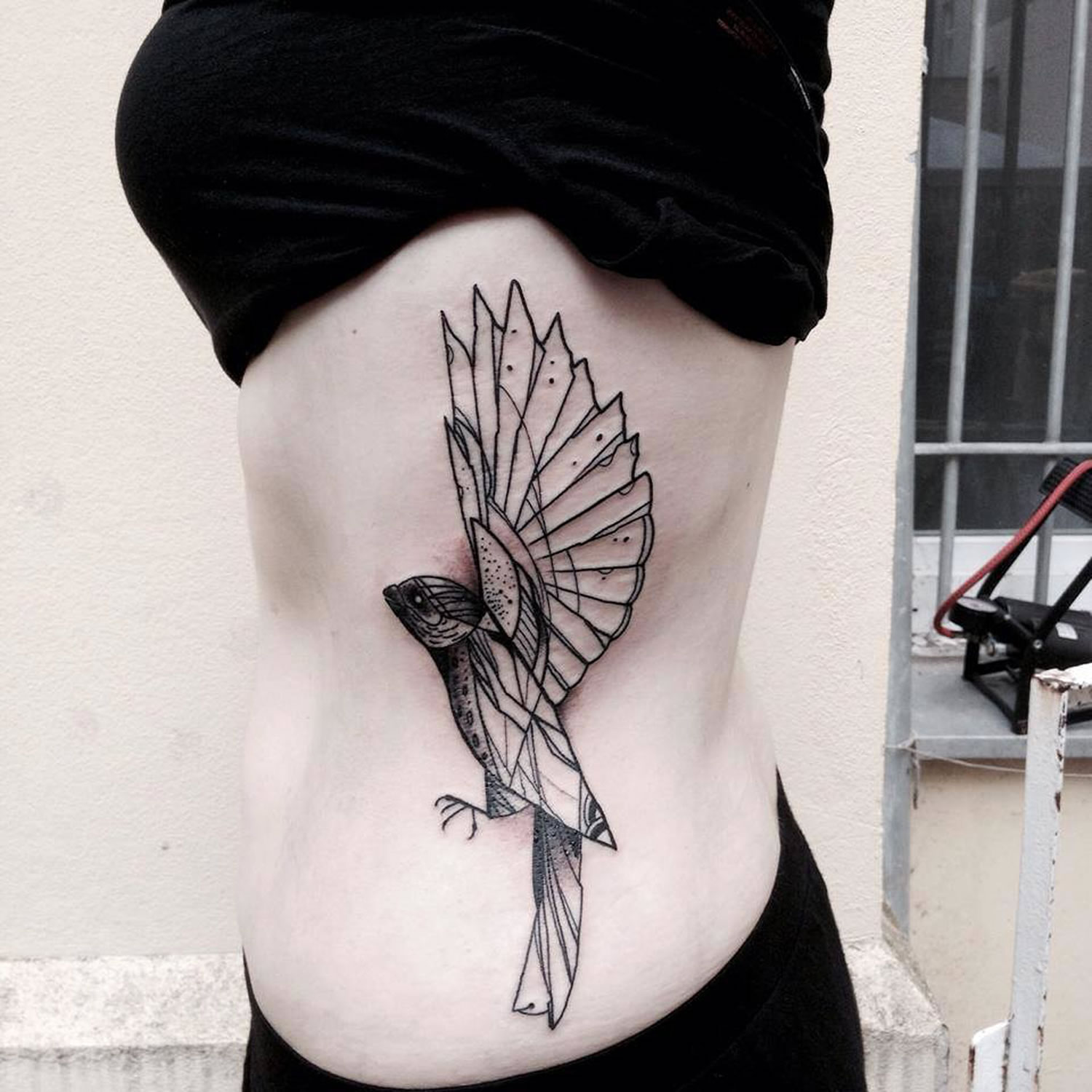 bird on rib cage, tattoo by Kamil Mokot