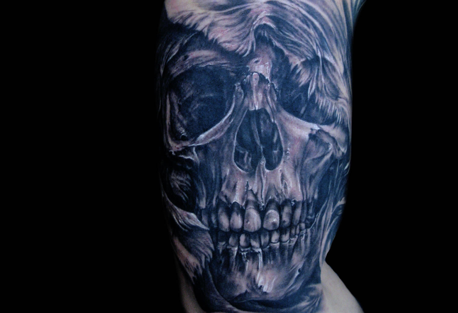 blue skull tattoo by tony mancia