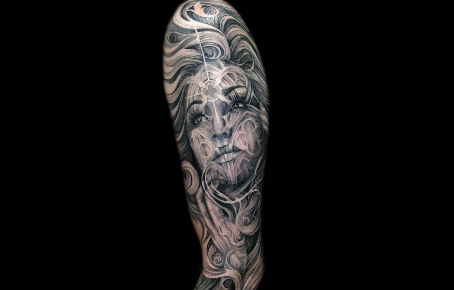 woman's face with decorative patterns on it, tattoo by tony mancia