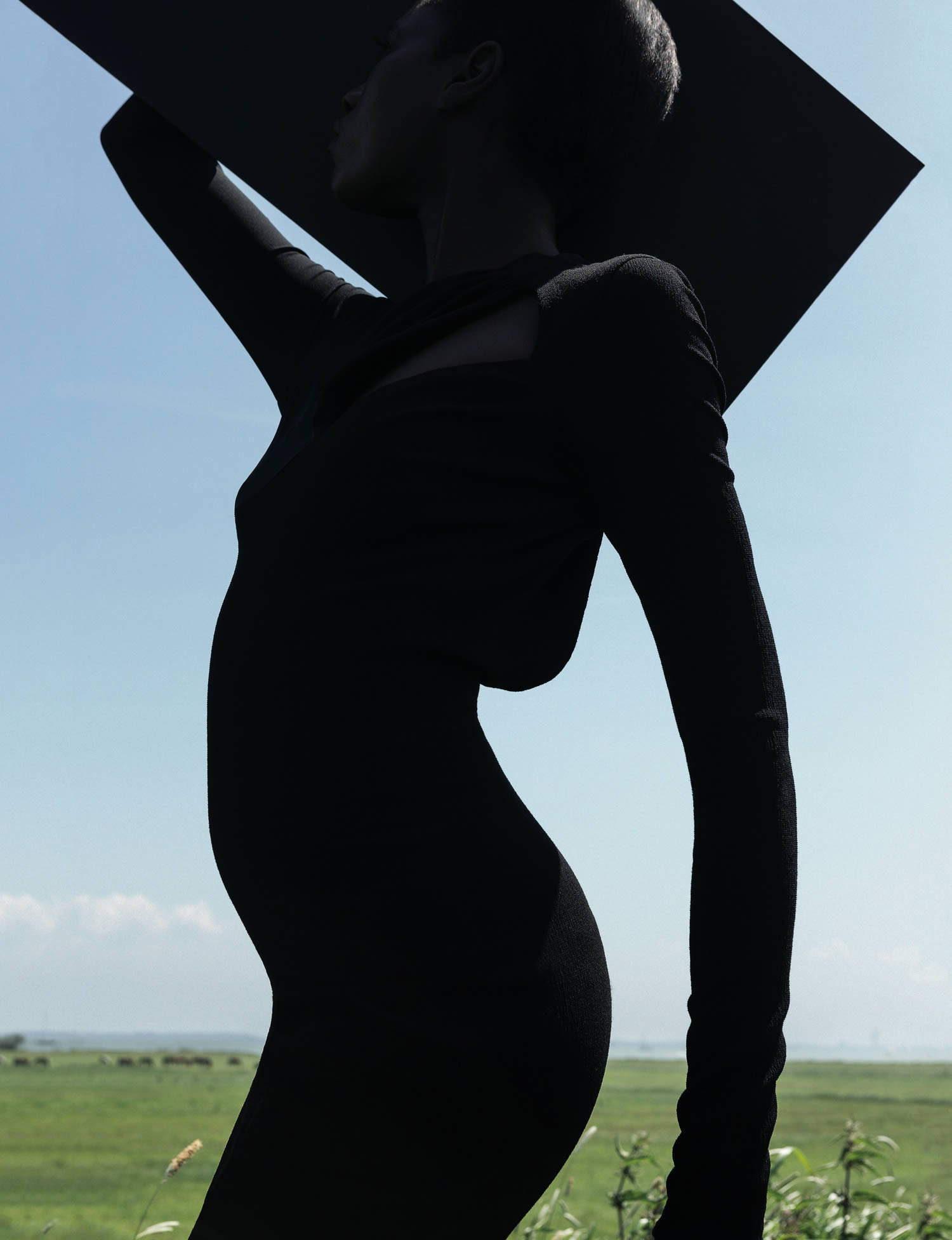 african woman posing against blue sky, photo by viviane sassen