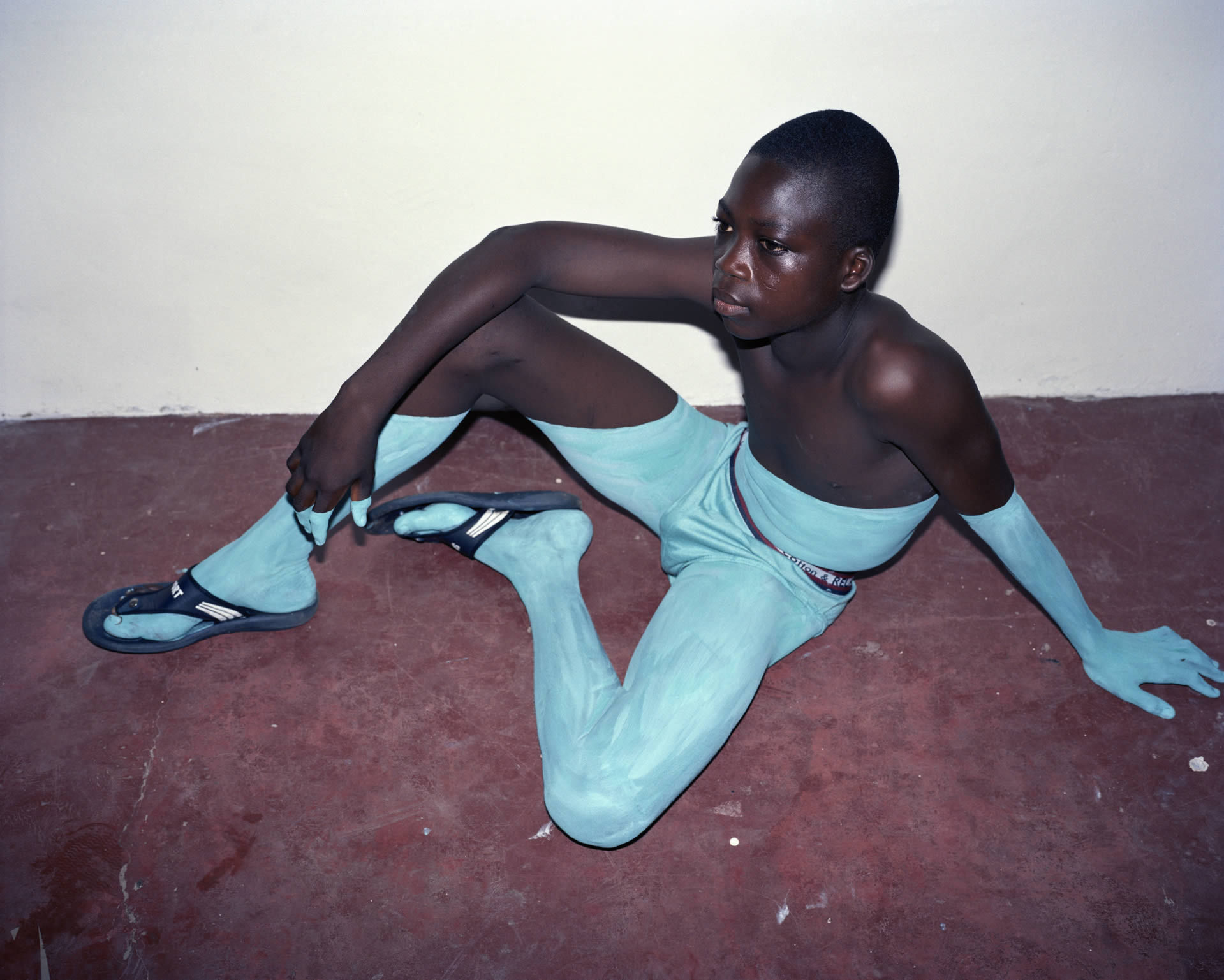 turquoise pants and sleeve, illusion, photo by viviane sassen