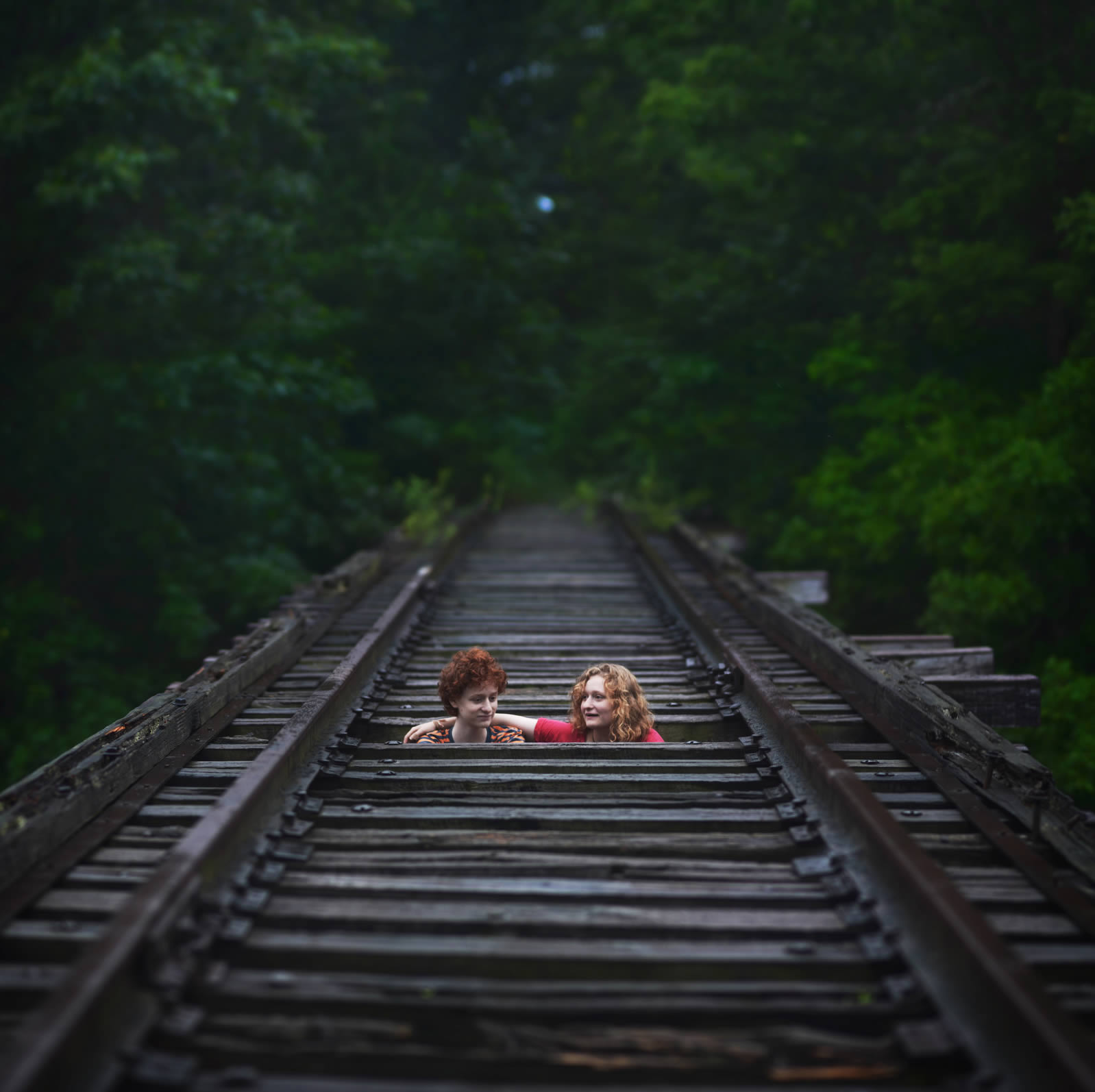"kids in train tracks, ""Back (Jinky's Home) by Zev."