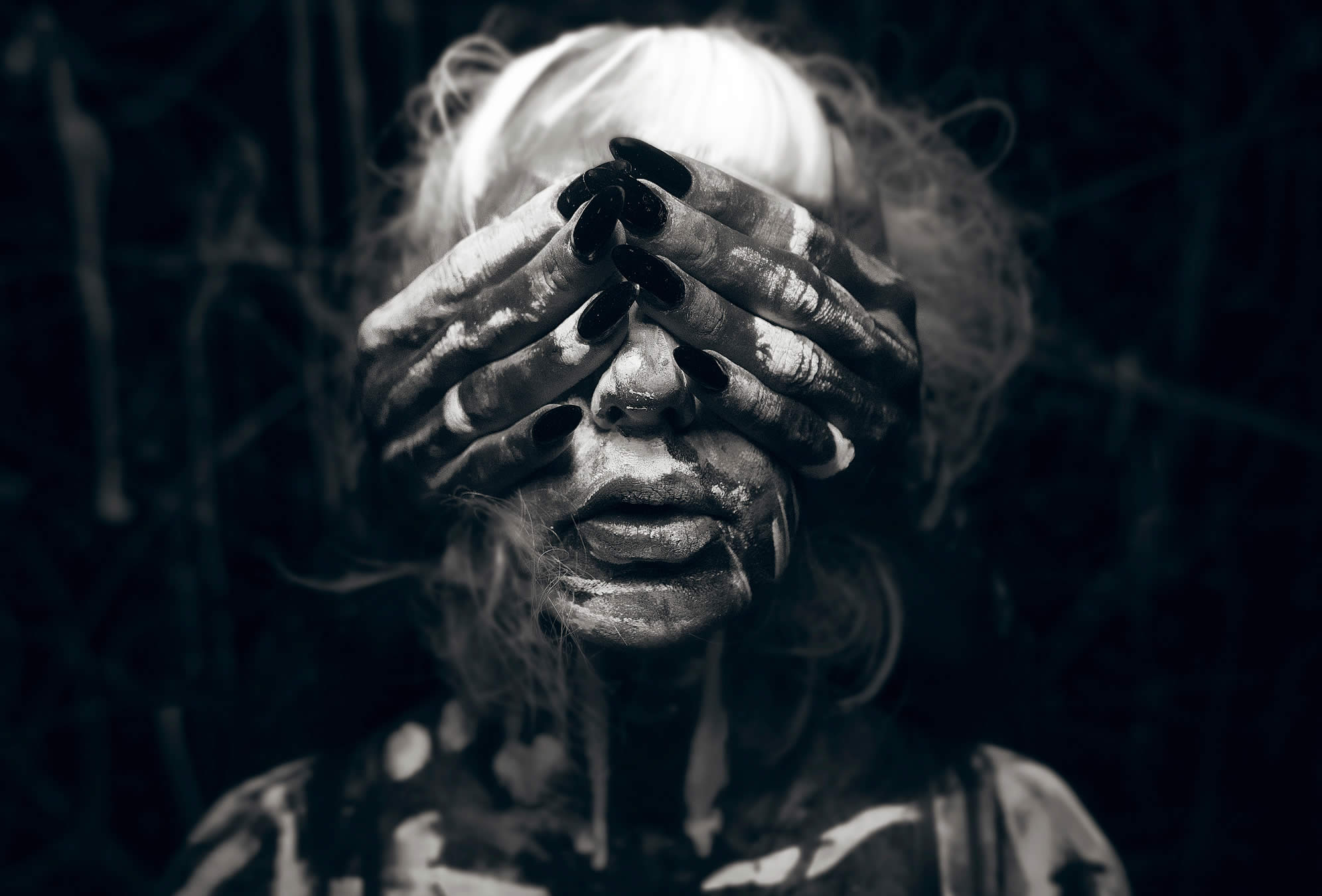 creepy lady with eyes covered, photo by kavan cardoza