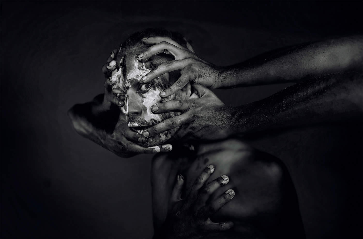 mud and face and hands, photo by kavan cardoza