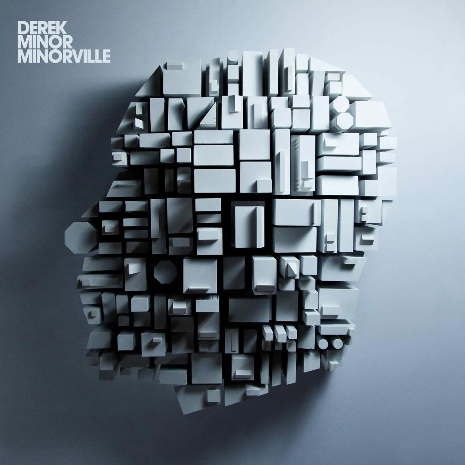 cubes forming a head, derek minor, minorville