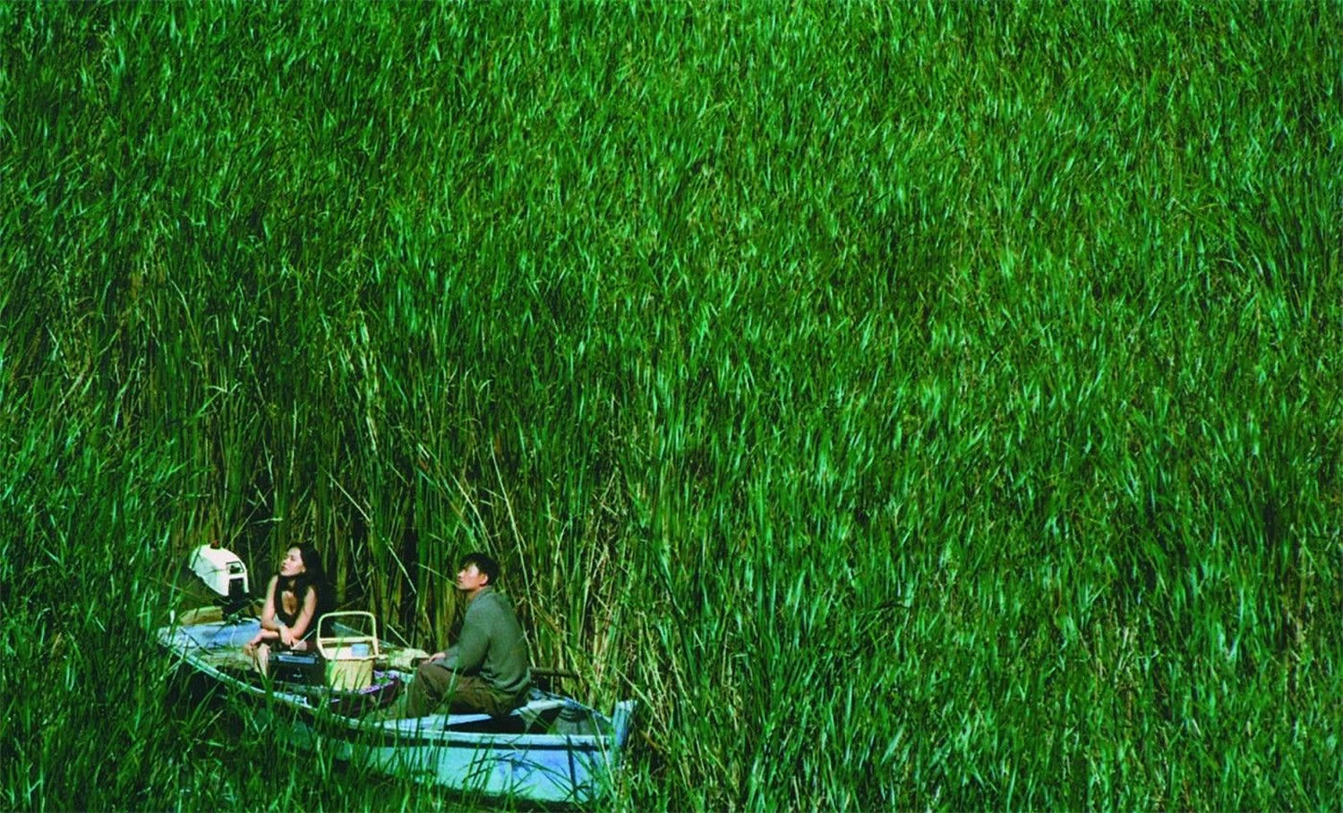 two people in boat in the movie The Isle, seom