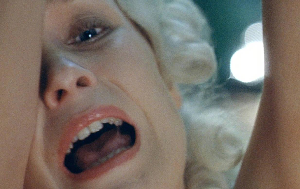 blonde woman screaming in the beast (la bete)