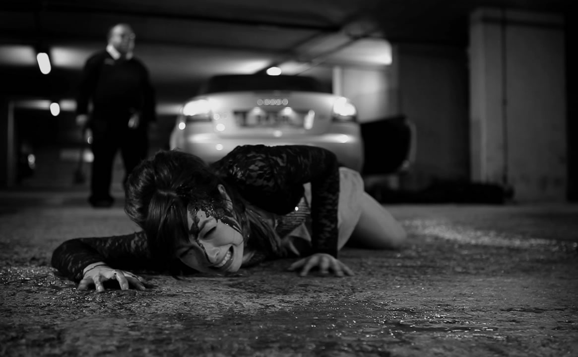 woman bleeding on the ground, killer coming behind her, The Human Centipede II: (Full Sequence)