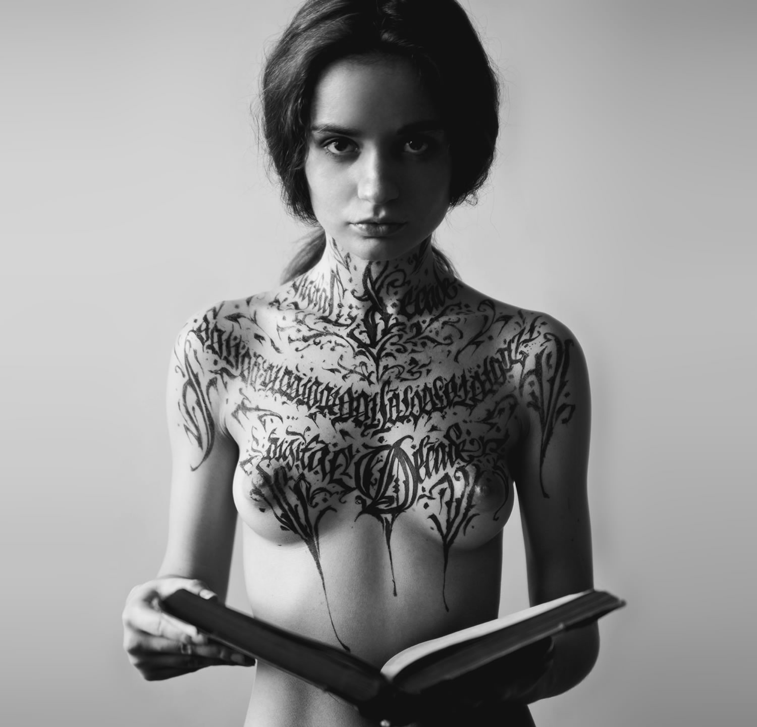 black and white picture of female holding a book
