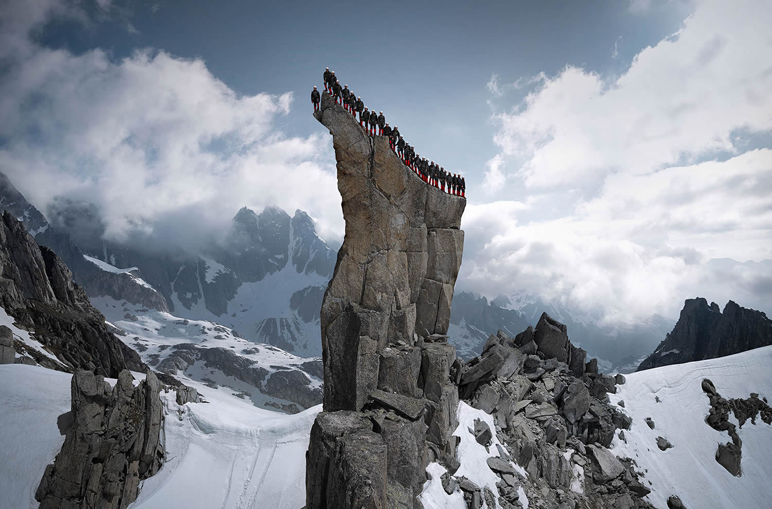 mountain climbers aligned on a rock, Robert Bösch mammut