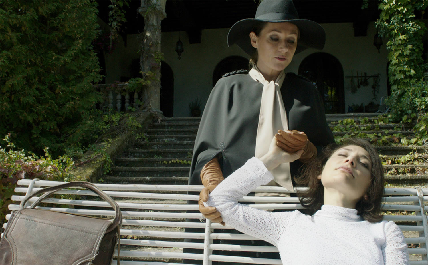 cynthia and evelyn holding hands in the duke of burgundy movie