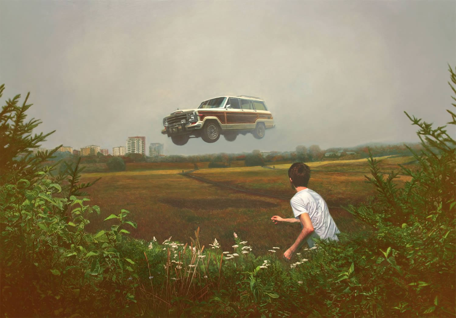 jeep flying in midair, over a field, by alex roulette