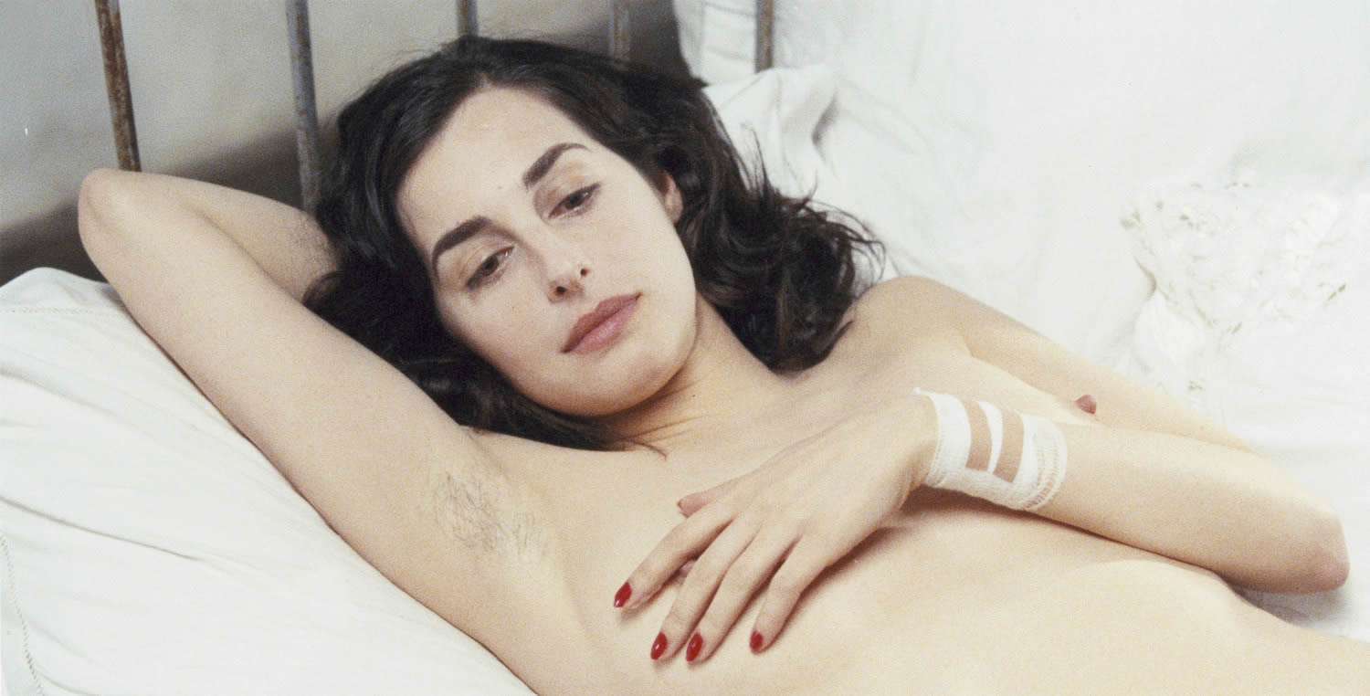 woman lying in bed with hairy armpits in anatomy of hell
