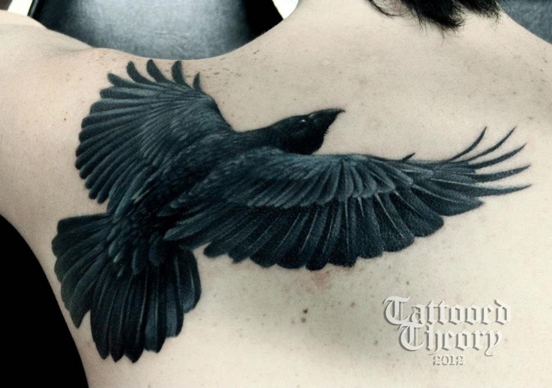 raven tattoo on back