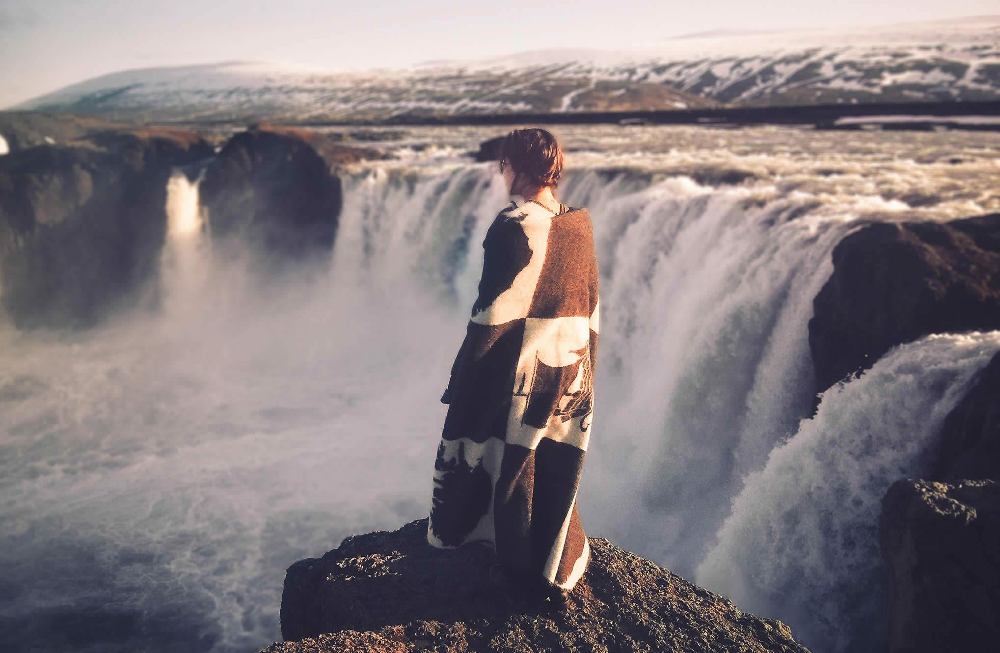 woman in front of waterwall, photos by elizabeth gadd