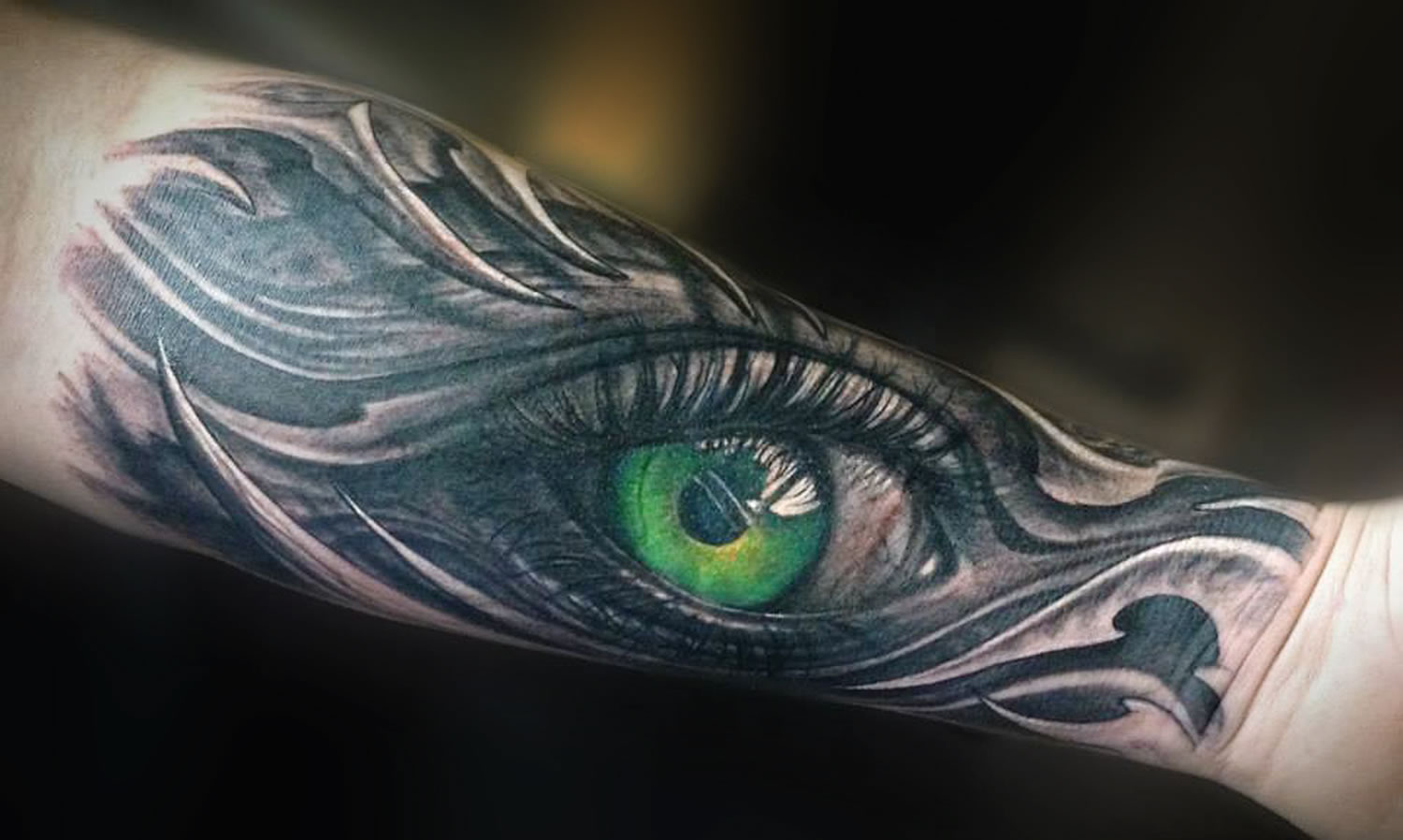 green realistic eye tattoo