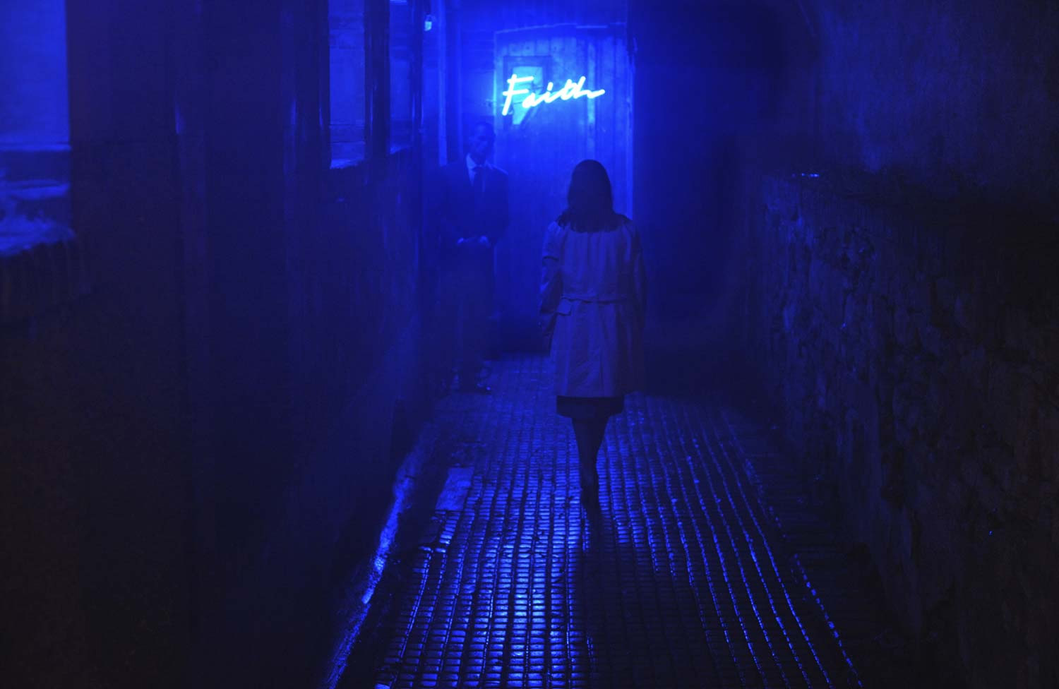 woman walking down alley, blut lighting. Alleluia movie