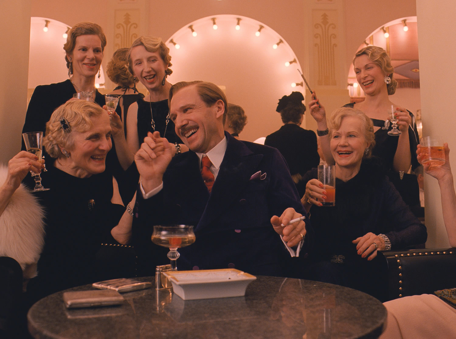 m gustave speaking with the ladies in the grand budapest hotel