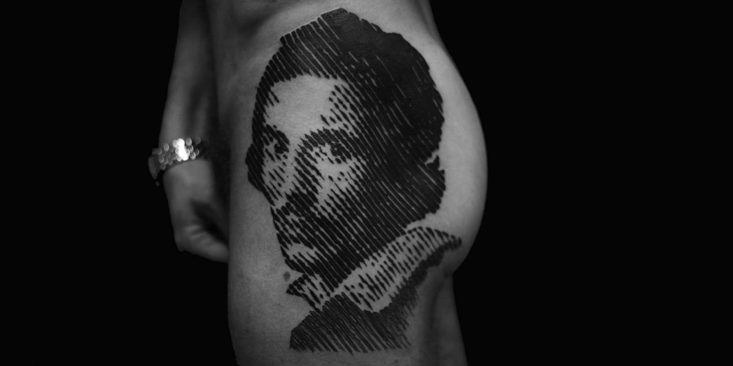 portrait on leg, black ink by sadhu le serbe
