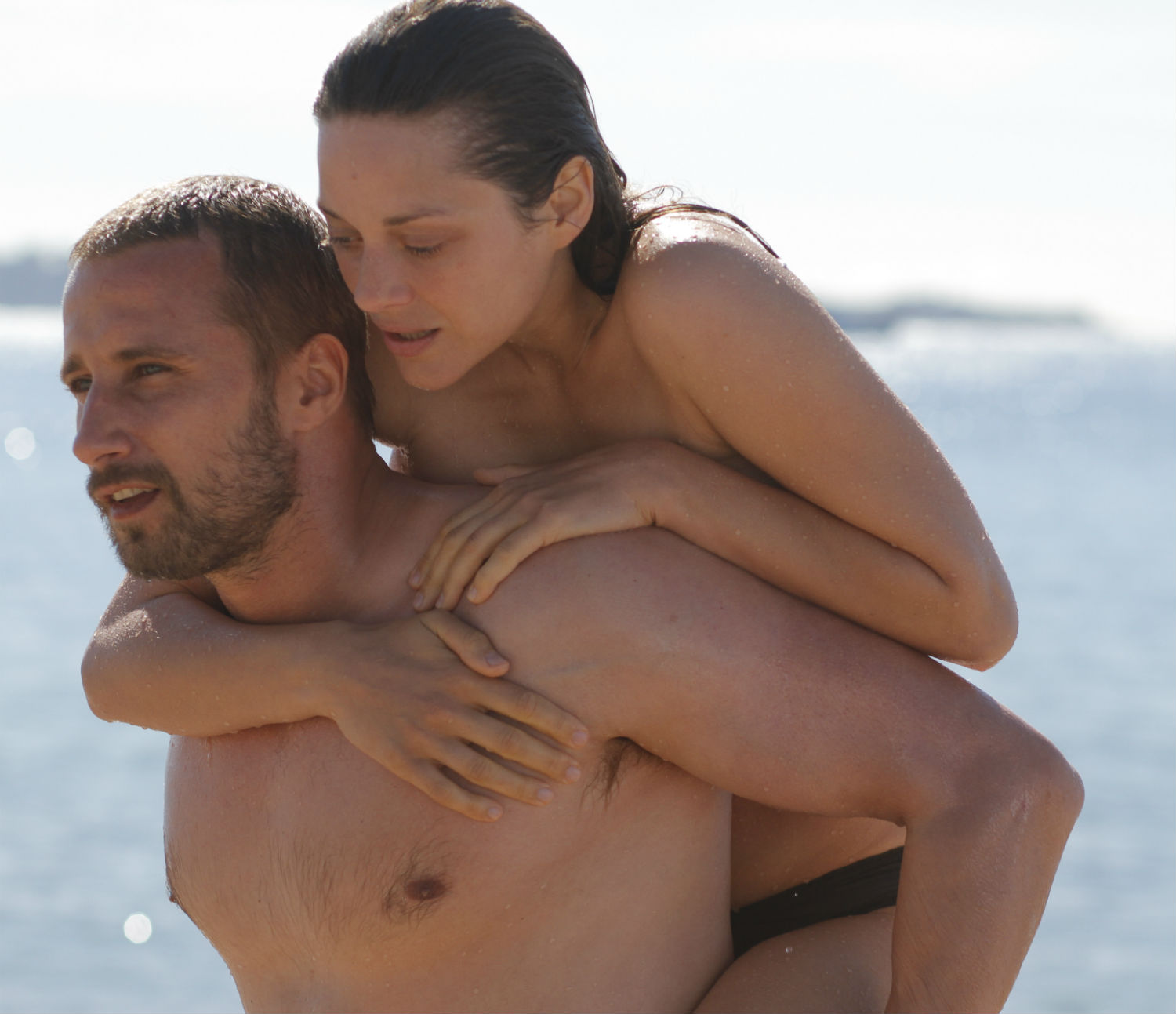 "Marion Cotillard emerges from the sea in ""Rust & Bone (2012)."