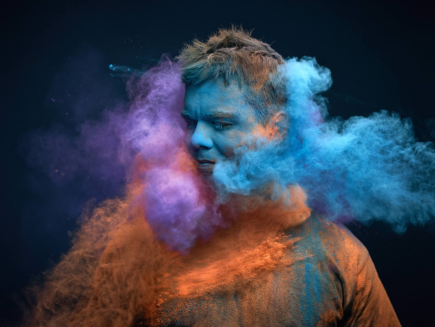 blue, purple, orange  powder thrown on man,Ars Thanea Portraits
