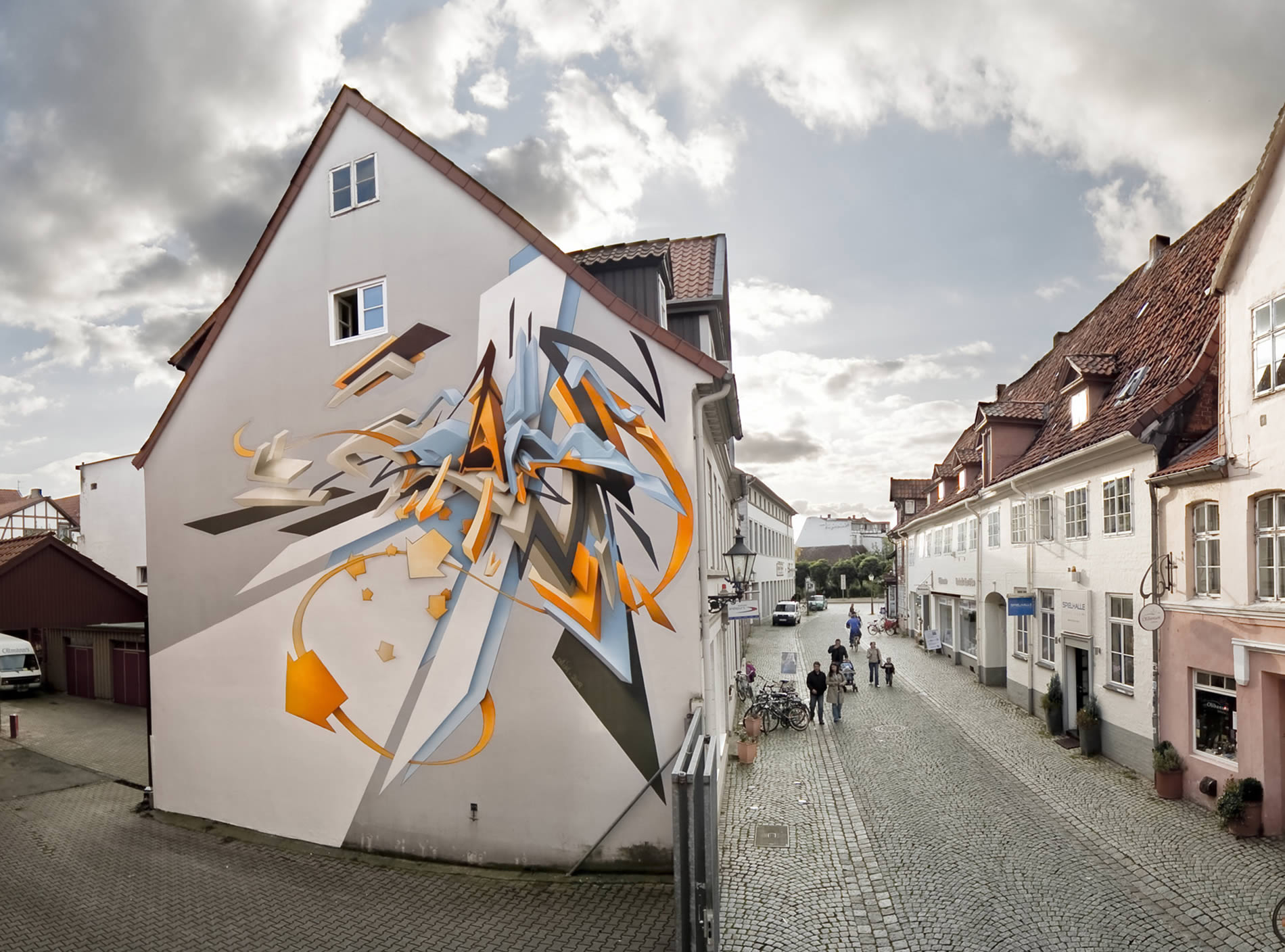 3d graffiti on building, art by daim