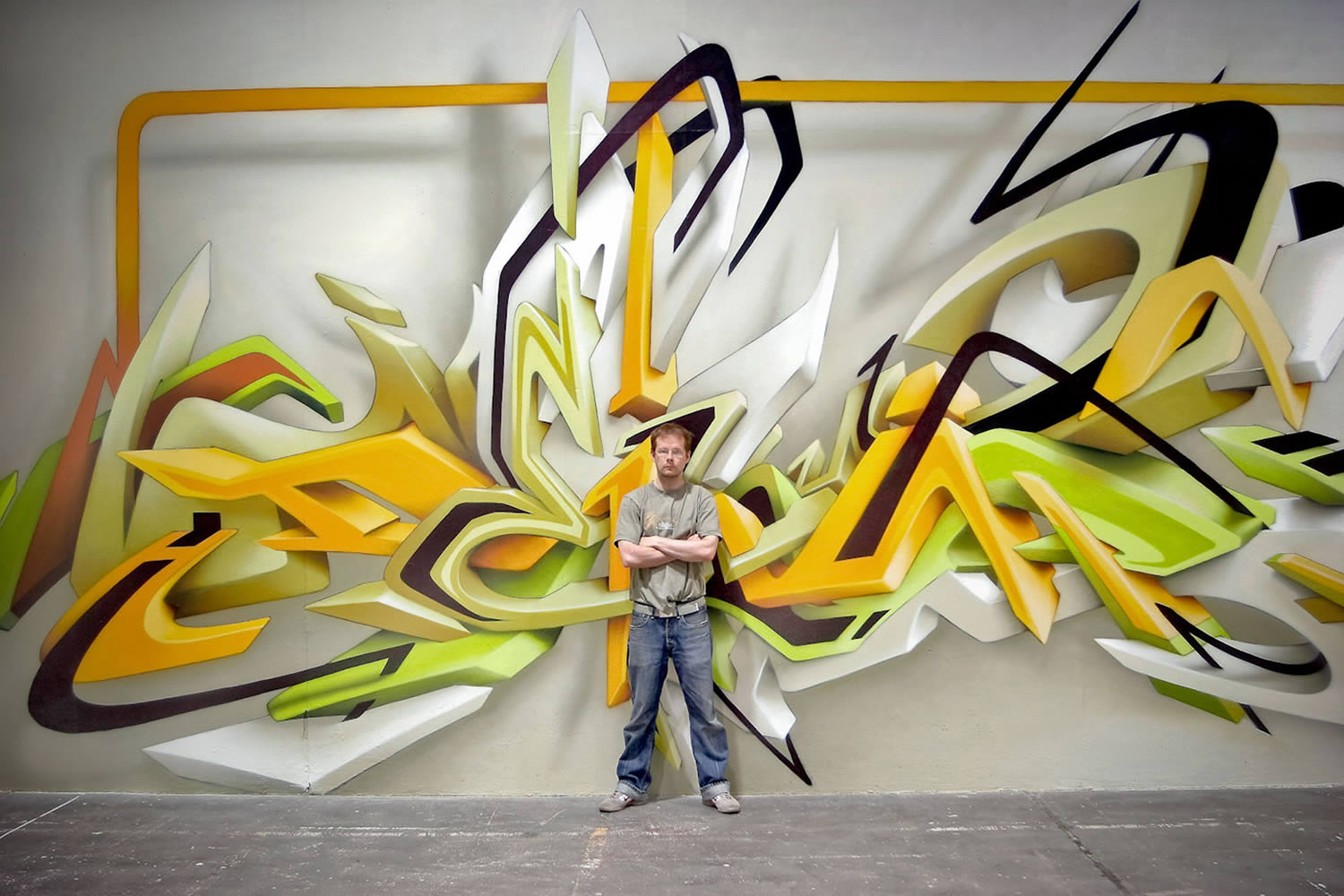 yellow 3d graffiti with DAIM posing in middle