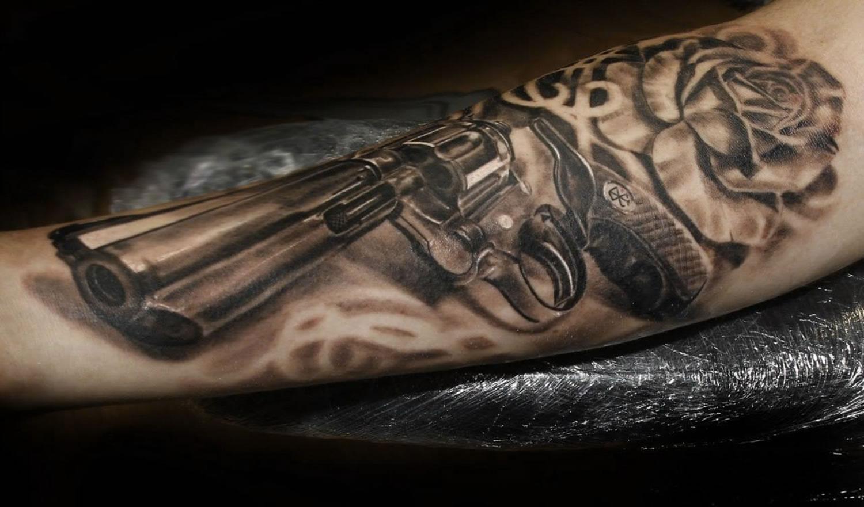 revolver gun tattoo by iwan yug