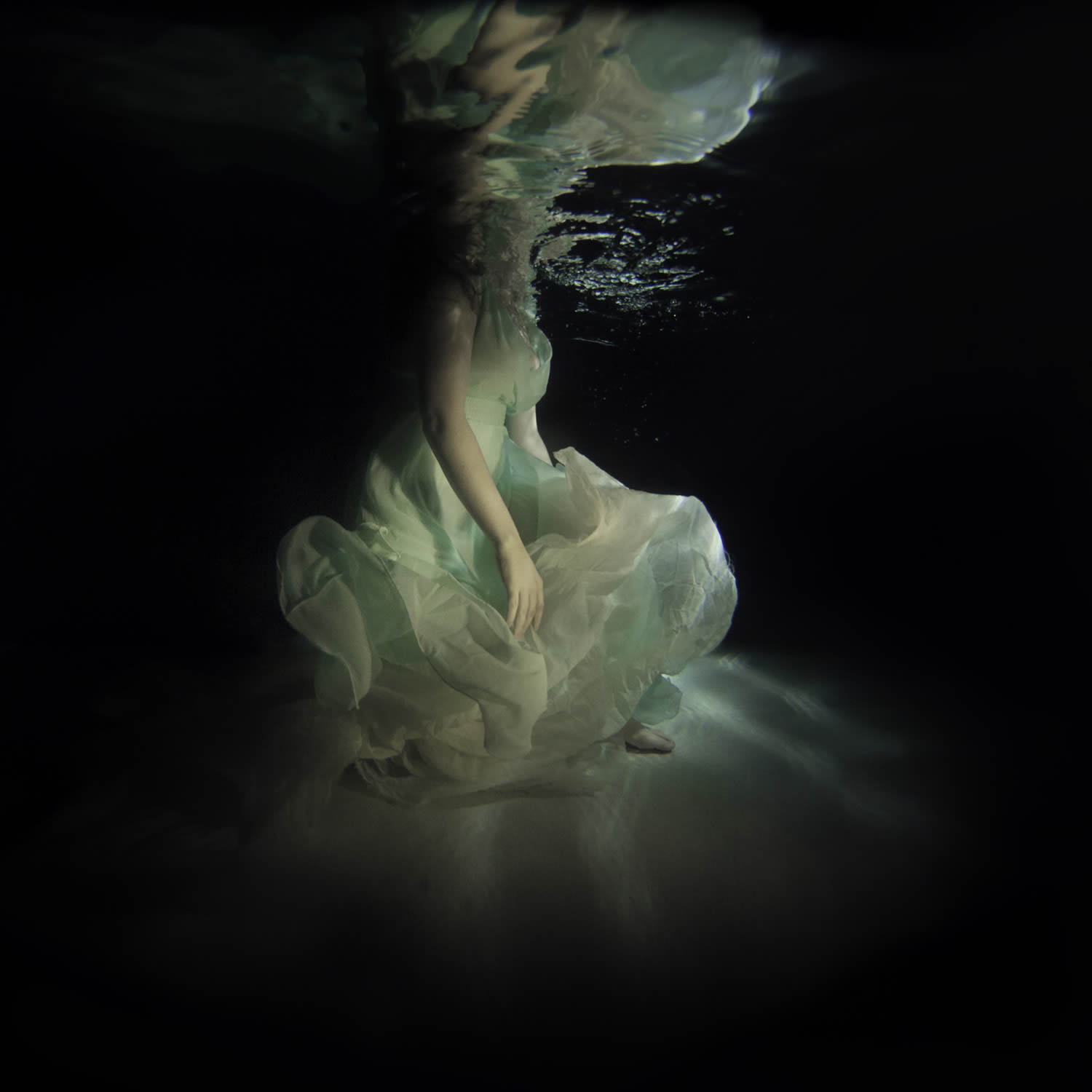 woman in green dress underwater, photo by jenna martin