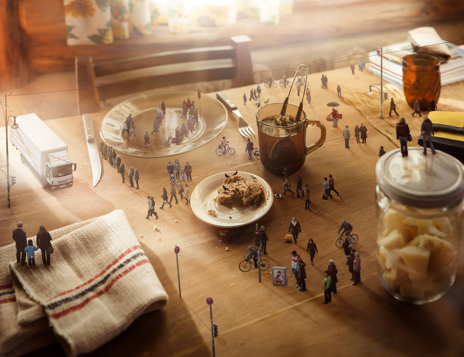 miniature people walking on kitchen table, by manuel archain