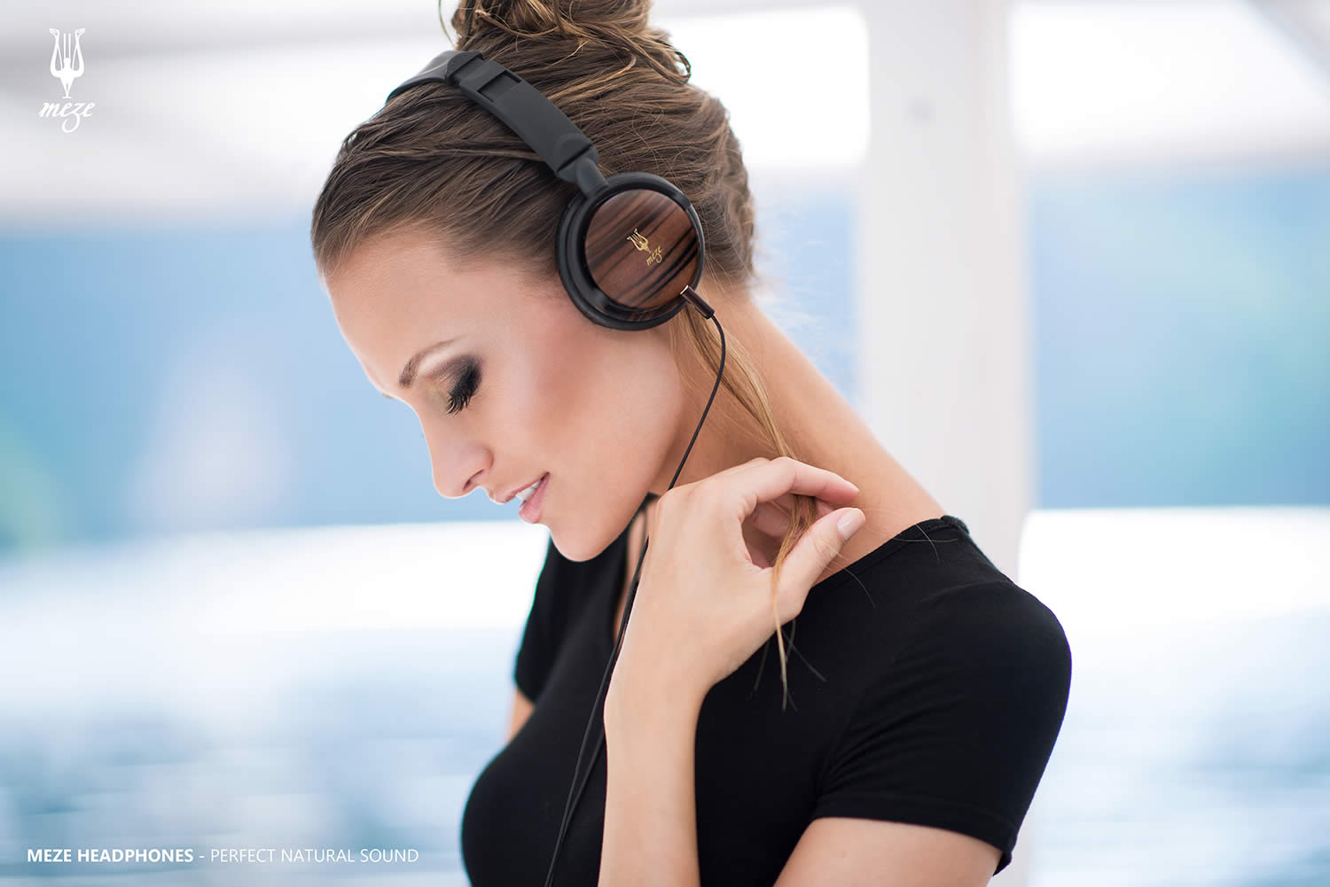 woman listening to music, meze headphones