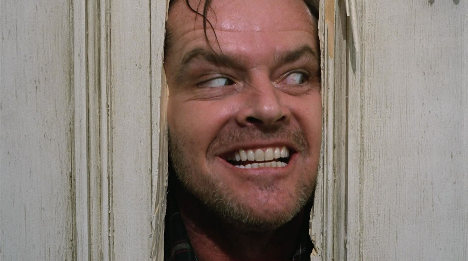 "Jack Torrance (Jack Nicholson) also tries to break through a door in ""The Shining"""