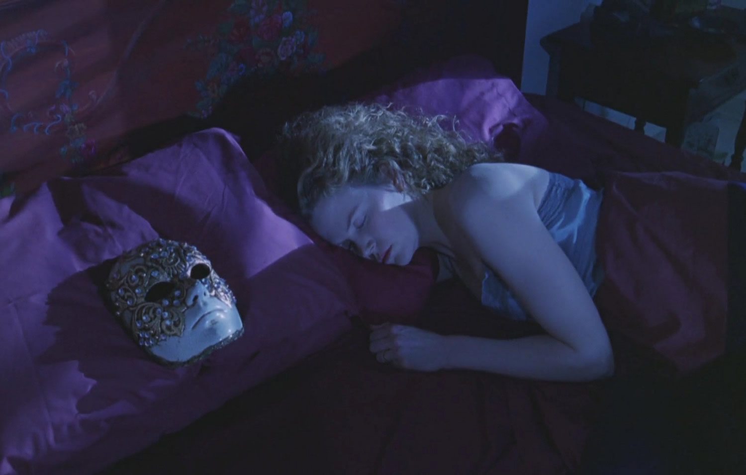 "A similar sleeping scene in ""Eyes Wide Shut"" (1999) © Warner Bros. Pictures."