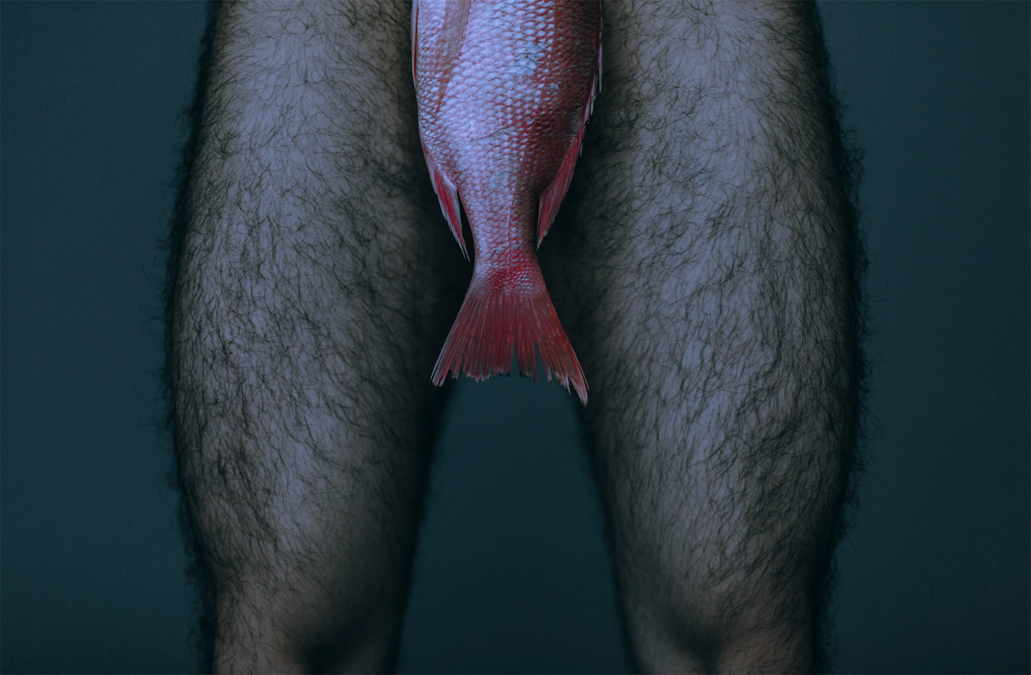 man with fish in front of body, photography by Daniel Molina