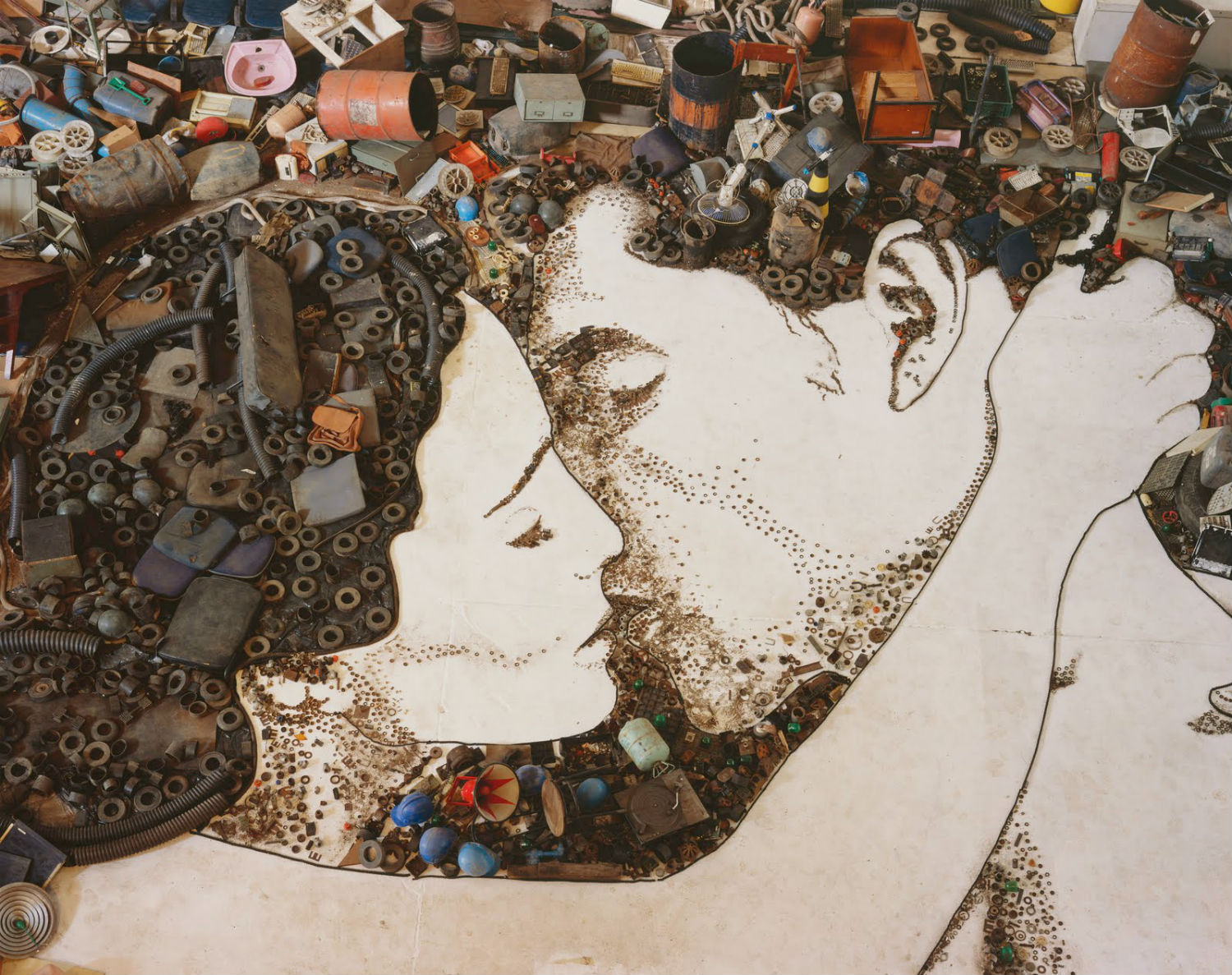 Vick Muniz art collage kissing couple