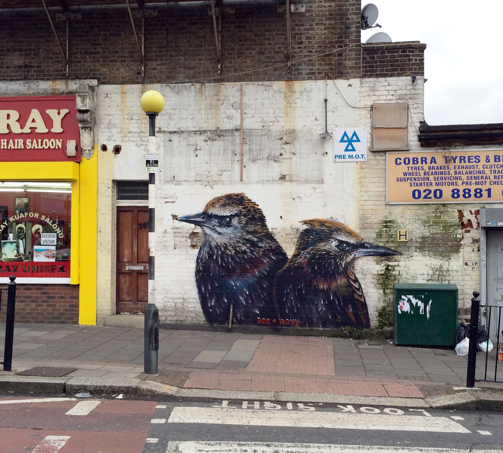 two birds, graffiti by whoam irony